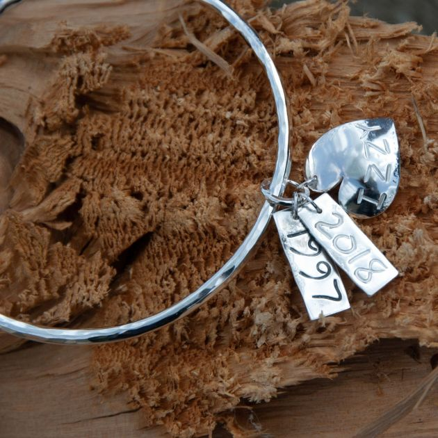 Beaten Bangle with rolling date & name tags