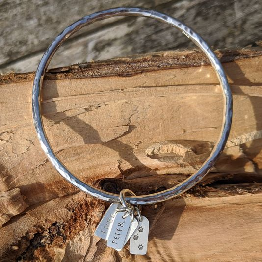 Beaten Bangle with 3 rolling personalised tags