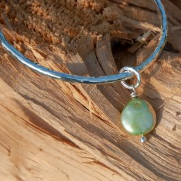 Beaten Bangle with rolling Freshwater Pearl